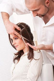 Professional hairdresser cut with scissors at salon — Stock Photo
