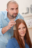 Professional hairdresser choose hair dye color at salon — Stockfoto