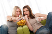 Student series - Two teenage girls watching TV — Stock Photo