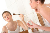 Body care woman - Applying powder in front of the mirror — Stock Photo