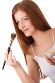 Body care series - Portrait of attractive woman applying powder — Stock Photo