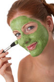 Body care series - Young woman with facial mask — Stock Photo