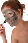 Body care series - Young woman with mud mask — Stock Photo