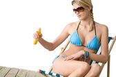 Beach - Young woman in bikini apply suntan lotion — Stock Photo