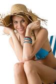 Beach - Happy woman in bikini with straw hat — Stock Photo