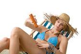 Beach - Young woman apply suntan lotion — Stock Photo