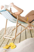 Beach - topless woman sitting on deckchair — Stock Photo