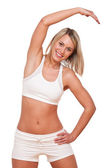 Fitness series - Young blond woman exercising — Stock Photo