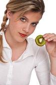 Healthy lifestyle series - Woman holding slice of kiwi — Stock Photo