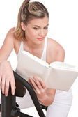 Fitness series - Woman reading book — Stock Photo