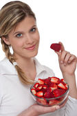 Healthy lifestyle series - Smiling woman with strawberry — Stock Photo