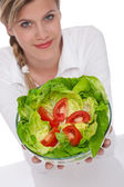 Healthy lifestyle series - Smiling woman holding salad — Stock Photo