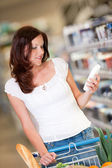 Shopping series - Brown hair woman in a shopping mall — Stock Photo