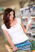 Shopping series - Brown hair woman in a shopping mall — Stock Photo