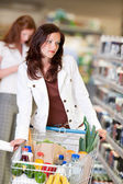 Shopping series - Beautiful brunette in cosmetics department — Stock Photo