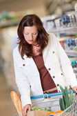Shopping series - Young woman in a supermarket — Stock Photo