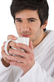 Morning - Young man in bathrobe with cup of coffee — Stock Photo