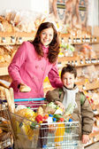 Grocery store shopping - Happy woman and child — Stock Photo