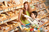 Grocery store shopping - Red hair woman and child — Stok fotoğraf