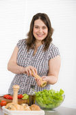 Cook - Plus size happy woman preparing salad — Stock Photo