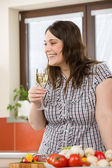 Cook - plus size woman with white wine and vegetable — Stock Photo
