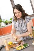 Cook - plus size woman prepare fish with white wine in modern ki — Stock Photo