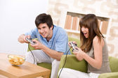 Student - happy teenagers playing video game having fun — Stock Photo