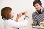 Students - happy teenage couple taking photo with camera — Foto Stock
