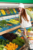 Grocery store shopping - Red hair woman in winter outfit — Stock Photo