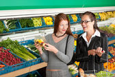 Grocery store shopping - Two business women — Stock Photo