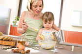 Baking - Woman with child preparing dough — Stock Photo