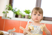 Child baking - little girl kneading dough — Stock Photo