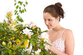 Gardening - Woman with Rhododendron flower blossom — Stock Photo