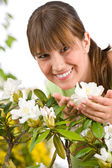Gardening - Portrait of woman with Rhododendron flower — Stock Photo