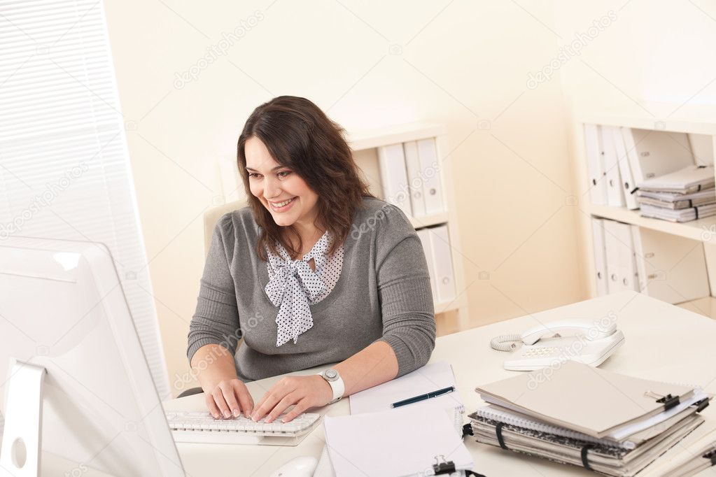 Young attractive business woman working at office with computer — Stock Photo #4680202
