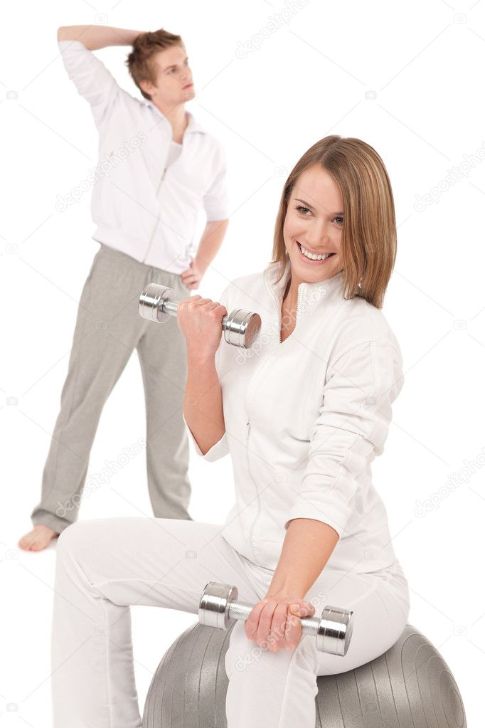 Young healthy couple training with weights and fitness ball on white  Stock Photo #4680502