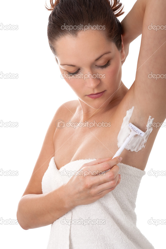 Young woman shaving her armpit  Stock Photo #4681801