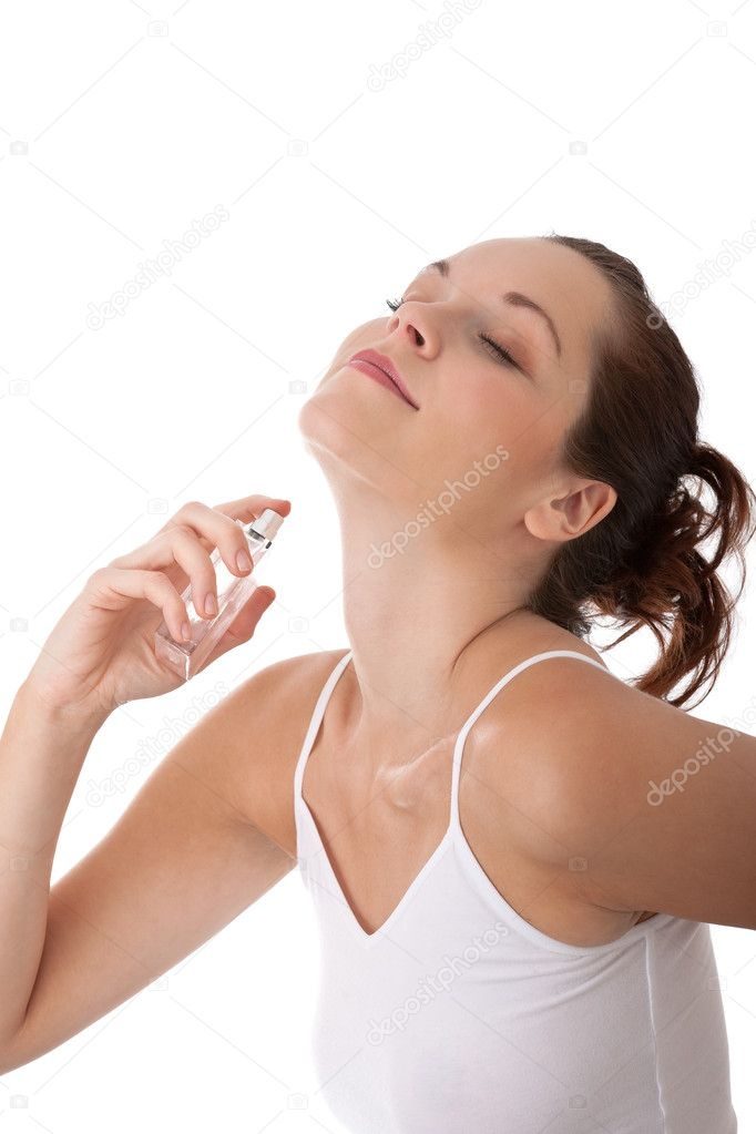 Young woman with perfume on white background  Stock Photo #4681812