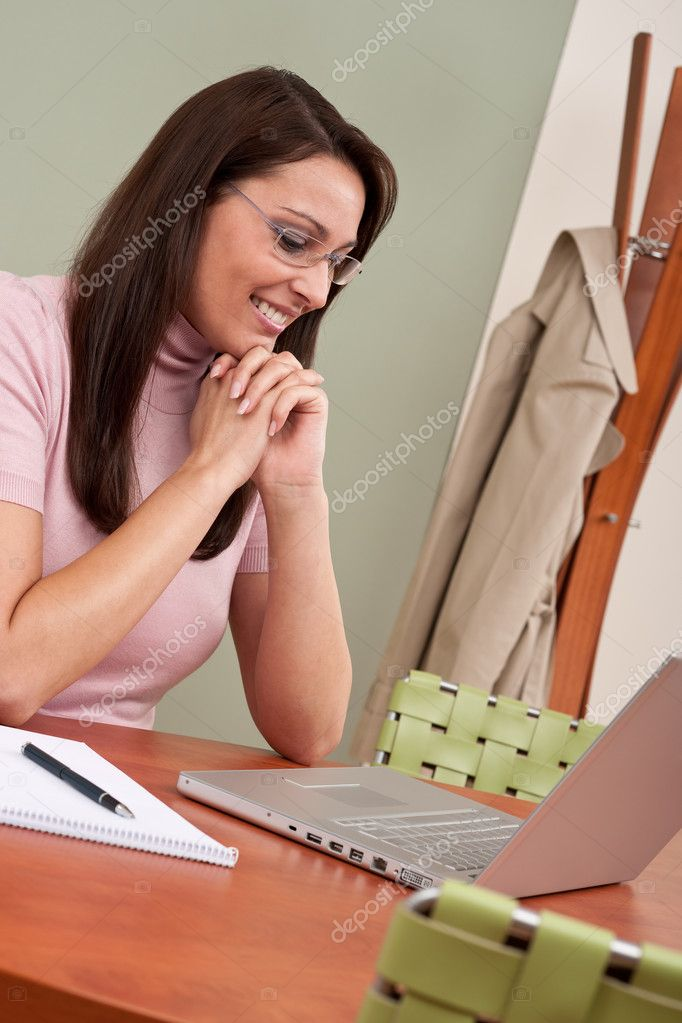 Smiling businesswoman with laptop sitting at office — Stock Photo #4681842