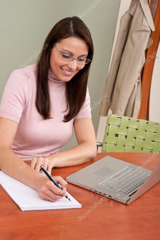 Smiling businesswoman with laptop sitting at office — Stock Photo #4681843