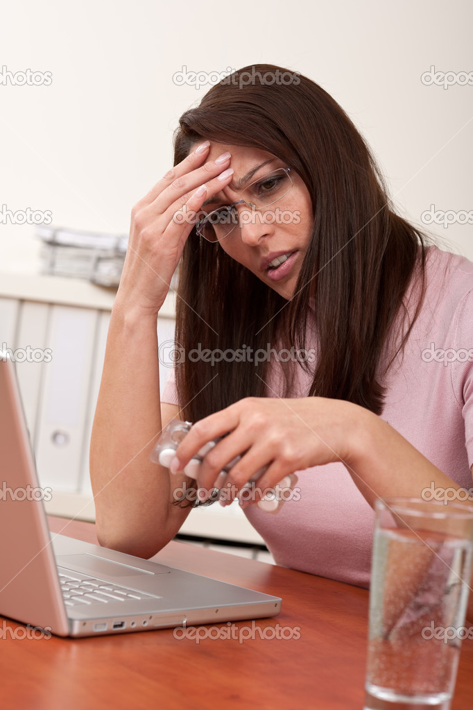 Businesswoman with headache take pill at office — Stock Photo #4681886