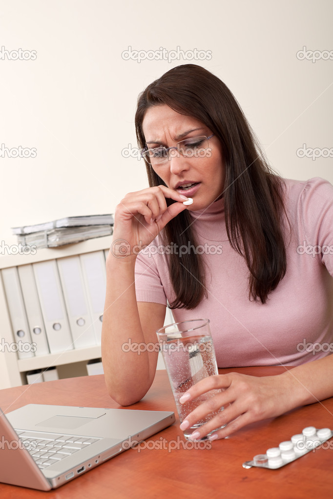 Businesswoman with headache take pill at office — Stock Photo #4681891