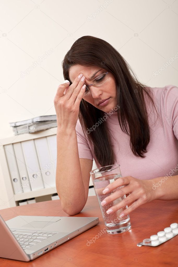 Businesswoman with headache take pill at office — Stock Photo #4681894