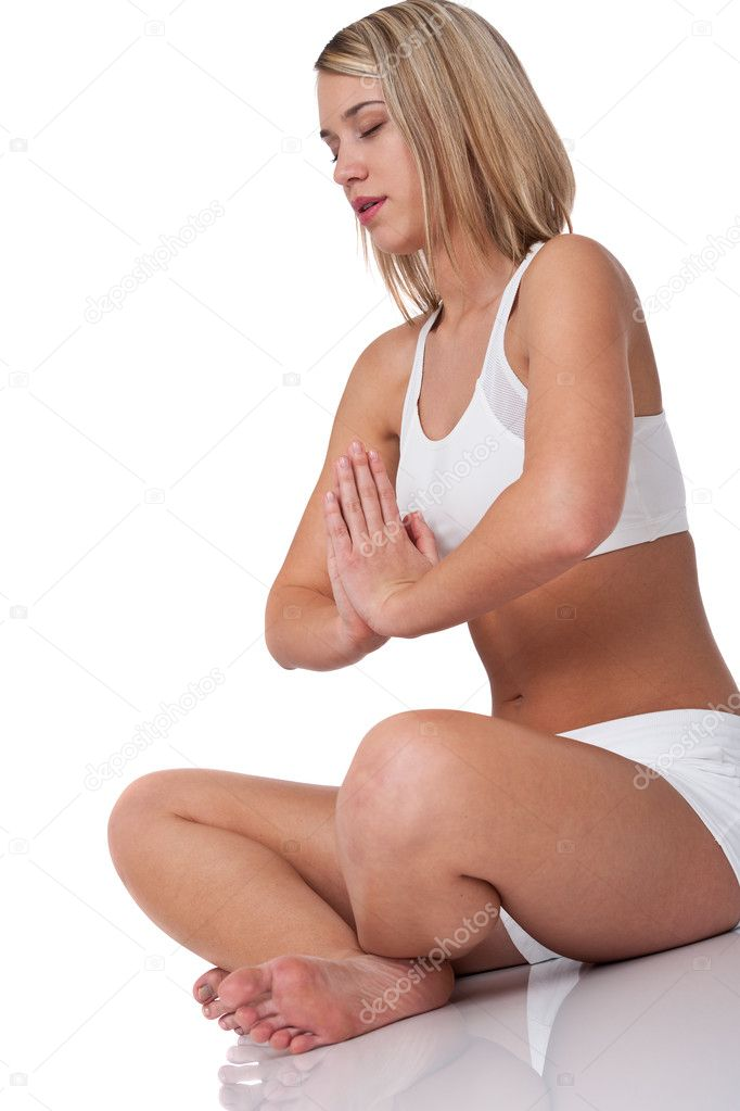 Blond woman in yoga position on white background — Stock Photo #4682592