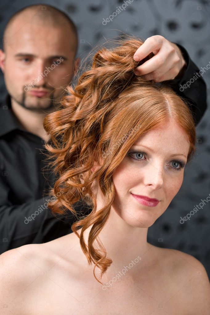 Professional hairdresser with long red curly hair fashion model at luxury salon — Stock Photo #4683888