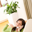 On the phone home: Happy woman calling — Stock Photo