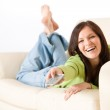 Cheerful woman switch television in living room — Stock Photo #4690659
