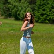 Young couple jogging outdoors in spring nature — Stock Photo