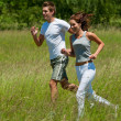 Young couple jogging outdoors in spring nature — Stock Photo #4690680