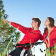 Young couple with mountine bike in spring nature — Foto de Stock
